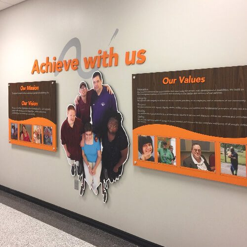 arc's mission statement, vision and values display on wall